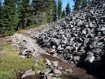 Trail across base of rock formation - PCT in Jefferson Wilderness