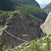 The suspension bridge crosses the Massa River in the gorge left by the glacier retracting. It was built in 2008
