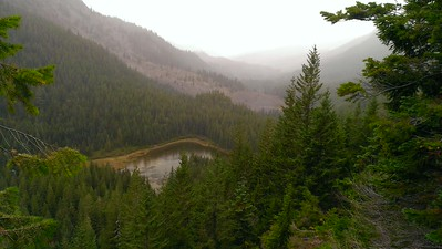 On the way out - the clouds and rain have arrived - Pansy Lake below