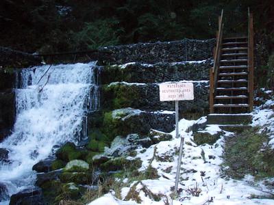 Dam below waterfall