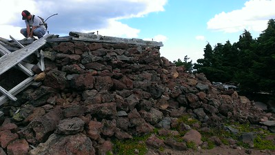 The built the lookout on a pile of cinder rocks and then mortared just the top few courses.  The lookout was built on top of this pile