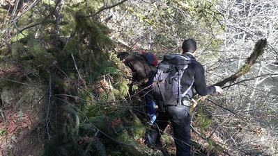 Kirk and Zack clearing some downed bruish from the pipeline trail