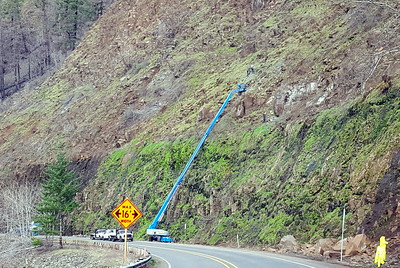 This was work that was happening on 224 on the way home.  If you look closely you can see men up on the hillside - I'm not sure what they were doing - drilling holes for dynamite to blast more rocks?  It is part of the rockfall improvement project that has been going on.
