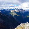 From the top of Trapper Peak on the Thornton Lakes trail - I think the peaks in the distance are (from left to right) - Cresent Creek Spires, Mt Terror, Mt Degenhardt, McMillan Spire and Pinnacle Peak