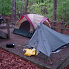 Nasty tent site with gravel base at Oconeechee State Park