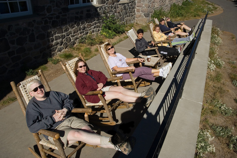 Ben, Sarah, Chris, Jenny, Morgan, Laurie, and Jennifer lounging outside the lodge before descending the trail down the crater rim to the lake