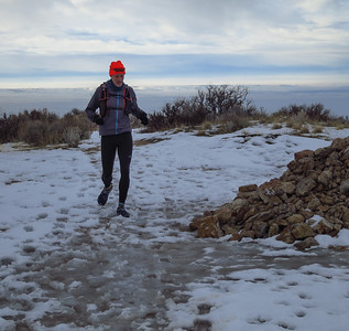 Dave finishes the sloppy climb to the Corrals rock pile.