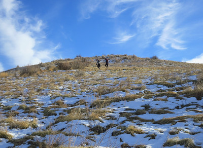 Paul and Mark get a head start up the switchbacks under a sunny sky.