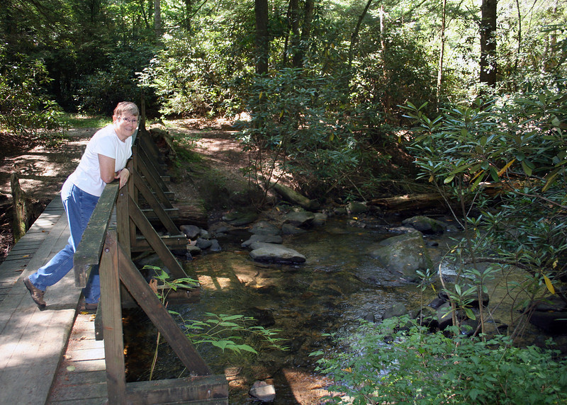 Susan on bridge over Chester Creek