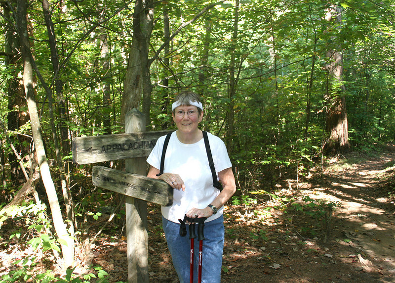 Susan at Benton MacKaye and Appalachian Trails sign