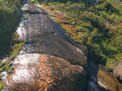 Water streaming over a trail side boulder. I refilled my water supply here on the way back.