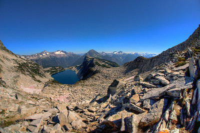 Hidden Lake from the saddle. Looking east across the lake one can see Forbidden Peak, Boston Peak, Johannesburg Mountain, Mount Formidable and others.