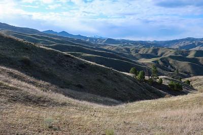 Glimpse of Danskin peak across folded hills.