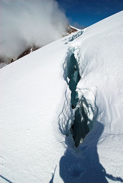Another snow bridge across a crevasse. You can see my shadow as I'm standing on it.