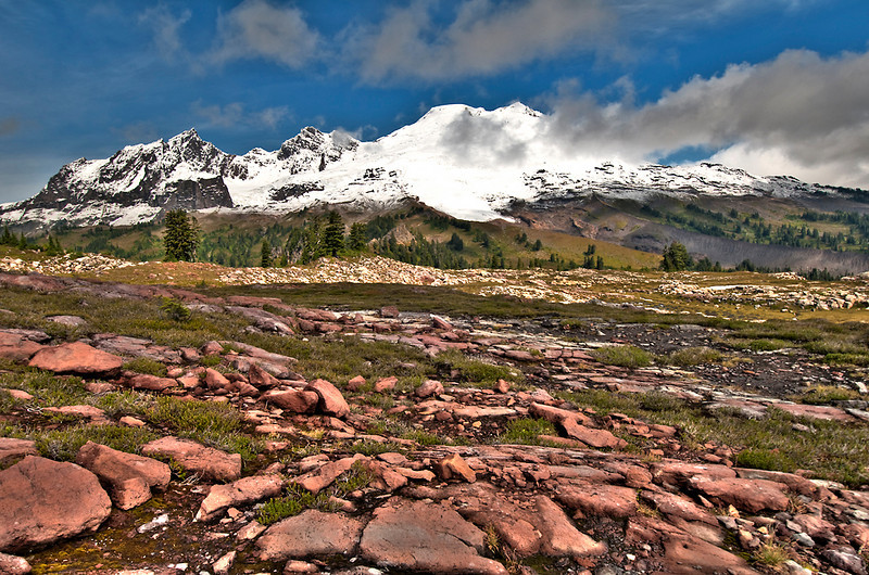 A dried up tarn, some red rock, the Black Buttes and Baker.