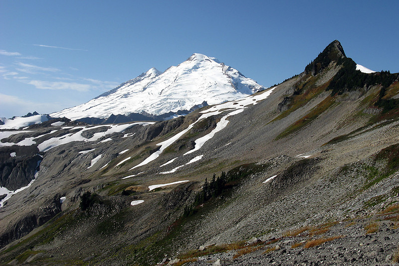 Mt. Baker with Coleman Pinnacle. Notice the trail traversing the base of Coleman.  It then climbs and bends around behind it.