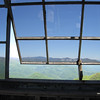 The very top of the fire tower has windows, partly blocking the sharp wind.