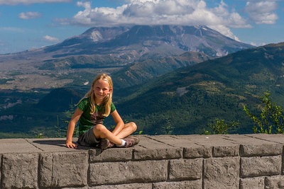 Hannah with Mount Saint Helens in the background at the Elk Rock Viewpoint.