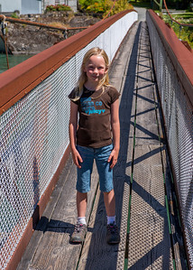Hannah crossing a suspension bridge by the Gorge Powerhouse.