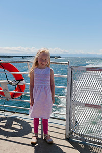 Hannah on the Clipper's rear deck as it enters Victoria's harbor.