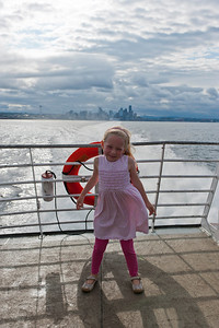 Hannah on the Clipper's deck with Seattle in the background.
