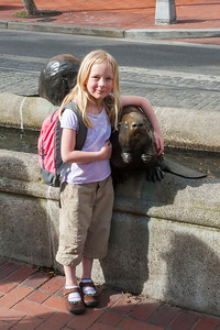 Hannah hugging a beaver statue near Pioneer Courthouse in Portland.