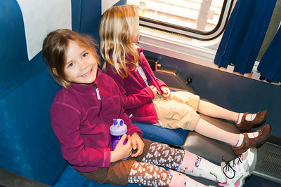 Kaitlyn and Hannah resting in their seats on the Coast Starlight.