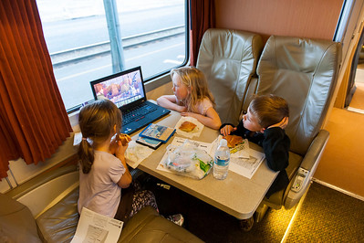 Kaitlyn, Hannah and Aaron watching a movie on the Amtrak Cascades on its way from Portland to Seattle.