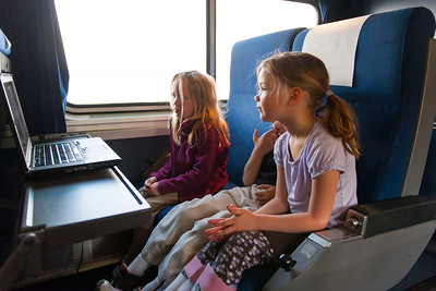 Hannah, Aaron and Kaitlyn watching a movie on the train.