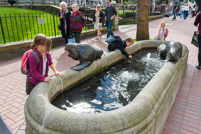 Kaitlyn, Aaron and Hannah with set of beaver statues near Pioneer Courthouse in Portland.