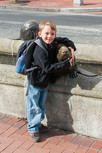Aaron hugging a beaver statue near Pioneer Courthouse in Portland.