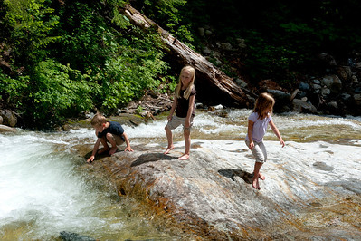 "Aaron, Hannah and Kaitlyn playing in the ""water slide"" area of Denny Creek."