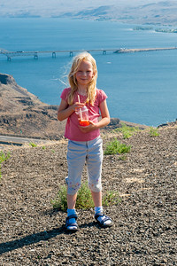 Hannah with the I-90 crossing of the Columbia River in the background.