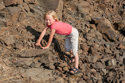 Hannah climbing over rocks near the Wanapum Dam on the Columbia River just south of Vantage, WA