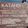 Weather-beaten summit sign