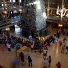 Inside Old Faithful Inn...August 25th...Christmas in Yellowstone.  Christmas tree (center) and carolers (top right)