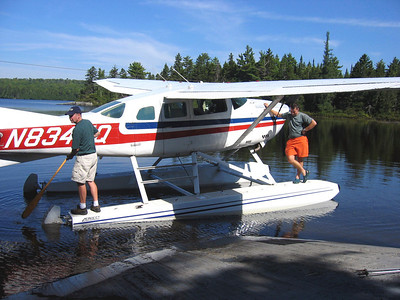 Tramper Al and the pilot go for a little paddle on Spectacle Pond