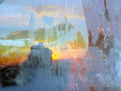 This was an experiment with a dirty window. The sunrise is behind me and through the window you can see Mt. Washington\'s summit