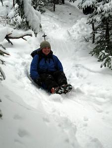 Me sledding down the mountain (photo courtesy of Bob Hayes)