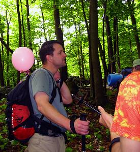 Tramper Al suddenly has a balloon...