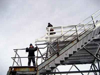Unadogger and Rocksnrolls climbing the fire tower on Carrigain\'s summit