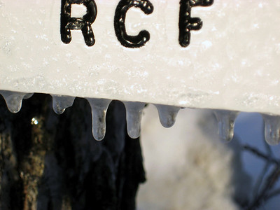 Frozen drips on the sign