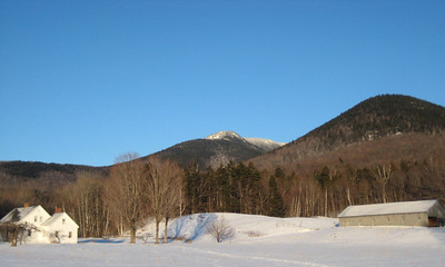 Whiteface and Wonalancet rising above a pretty farm.