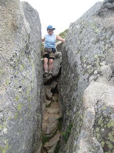 Kaboose descending between two big boulders