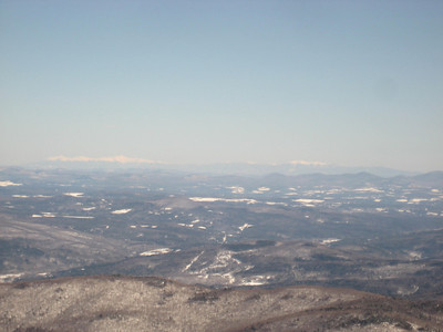 The Presidential Range and Franconia Ridge in New Hampshire way off in the distance