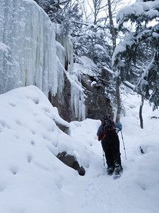 Me and the ice wall (photo courtesy of HikerBob)
