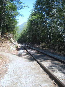 Crossing the railroad tracks and heading up the hill on the Ethan Pond Trail.