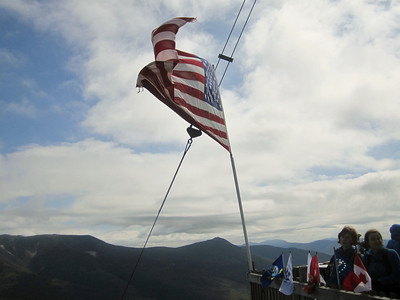 The smaller flag on the summit