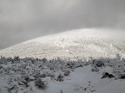 Hikers heading down from the blustery summit