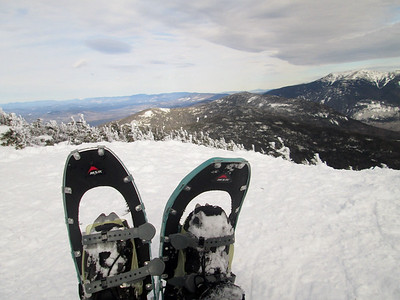Taking a break... first time on snowshoes this year.